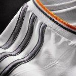gli inserti in arancione nella nuova maglia del Real Madrid